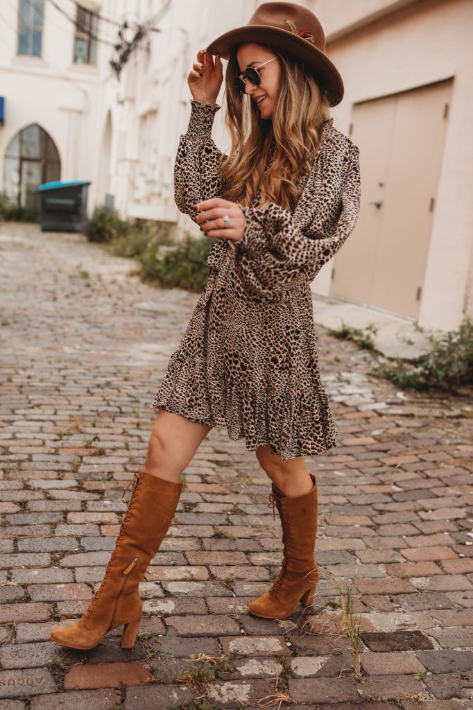 Shannon Jenkins of Upbeat Soles styles a cute date night fall outfit with Chicwish leopard dress, suede lace up boots, and felt hat