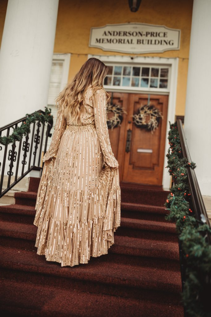 Shannon Jenkins of Upbeat Soles styles a Christmas dress outfit with gold sequin long dress and lace up Vince Camuto heels