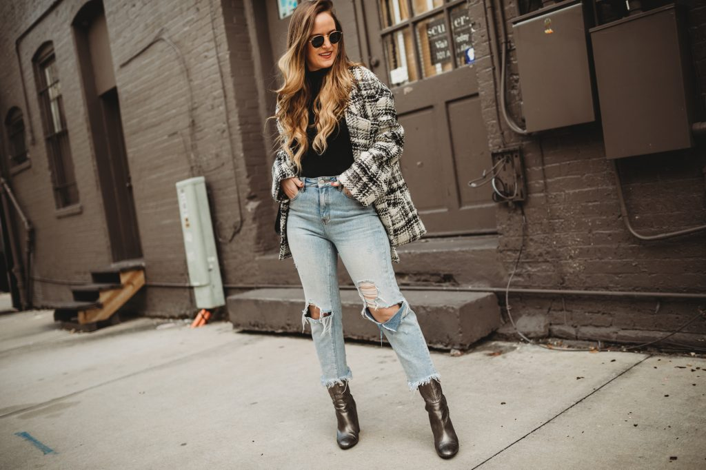 Shannon Jenkins of Upbeat Soles styles an edgy winter outfit styled with a tweed oversized coat, black turtleneck, and mom jeans