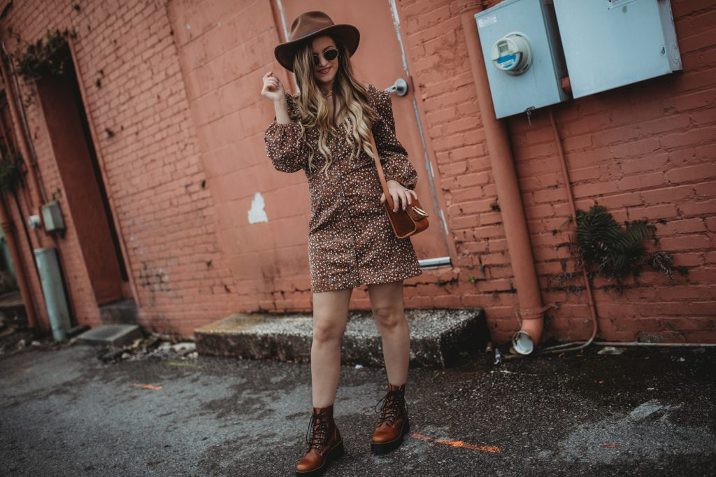 Shannon Jenkins of Upbeat Soles styles an edgy spring transition outfit with Free People corduroy dress and Dr Marten chunky boots