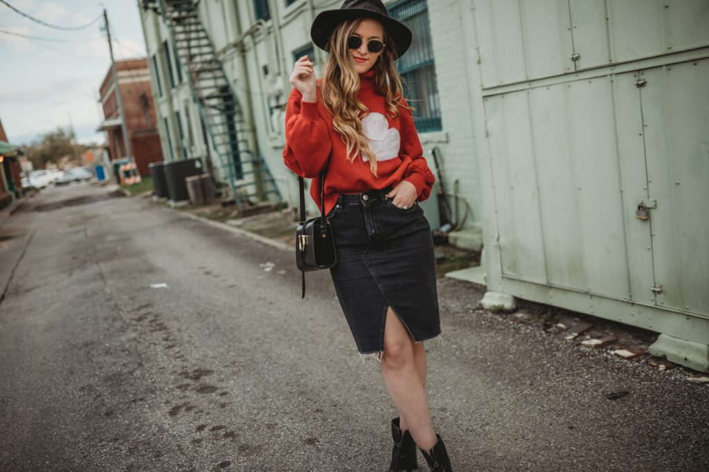 Shannon Jenkins of Upbeat Soles styles a cute date night Valentine's Day outfit with heart sweater, black pencil skirt, and black ankle boots