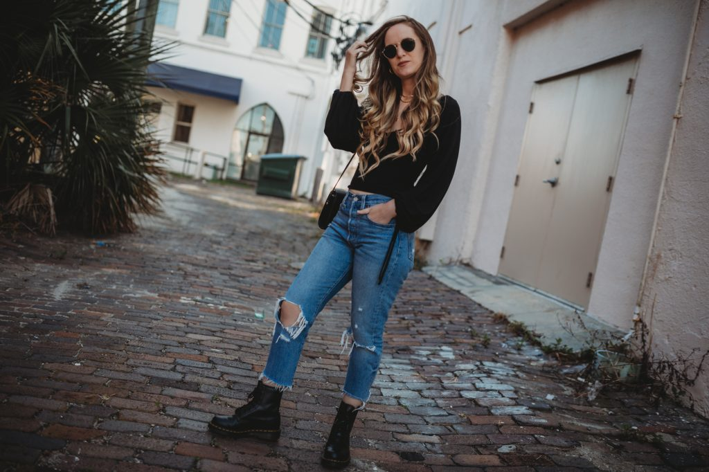 Shannon Jenkins of Upbeat Soles styles a spring edgy outfit with black Chicwish top, Levi's jeans, and Dr Martens boots