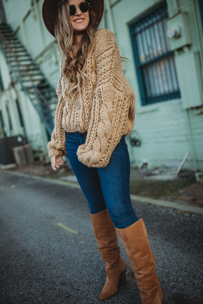 Shannon Jenkins of Upbeat Soles styles a weekend winter outfit with chunky sweater, slouchy boots, and dark skinny jeans