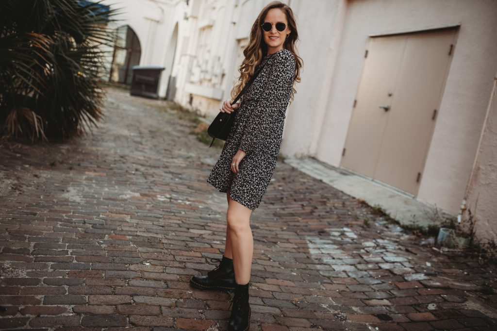 Shannon Jenkins of Upbeat Soles styles a boho spring transition outfit with Target flowy dress, Dr Martens combat boots, and Ray Bans