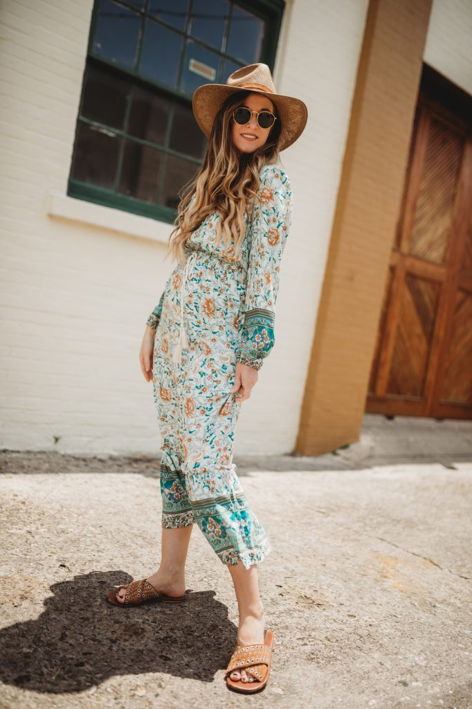 Shannon Jenkins of Upbeat Soles styles a spring maternity outfit with a mint floral Chicwish maxi dress, Janessa Leone hat and slide sandals