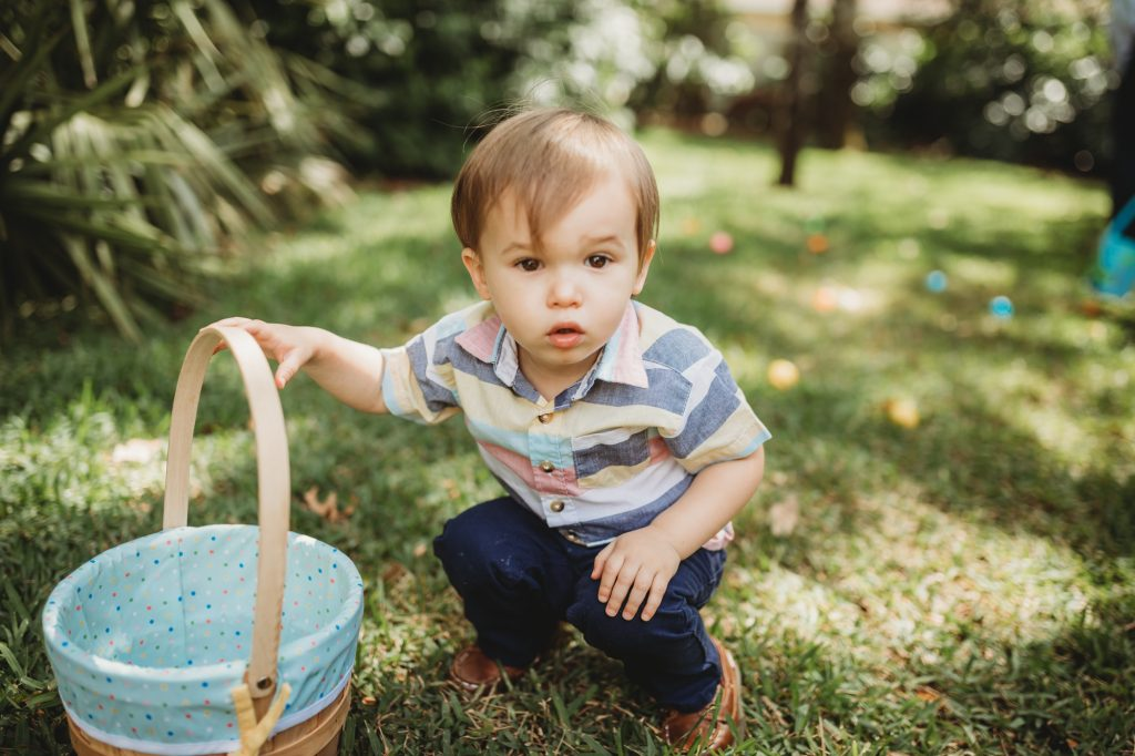 Shannon Jenkins of Upbeat Soles shows family Easter pictures with toddler boy Easter outfit and egg hunt photos