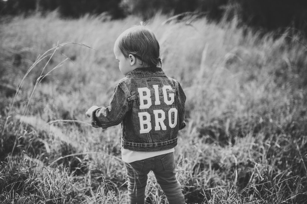 Shannon Jenkins of Upbeat Soles does a cute baby announcement with sibling and mom, dad, and big brother denim jackets