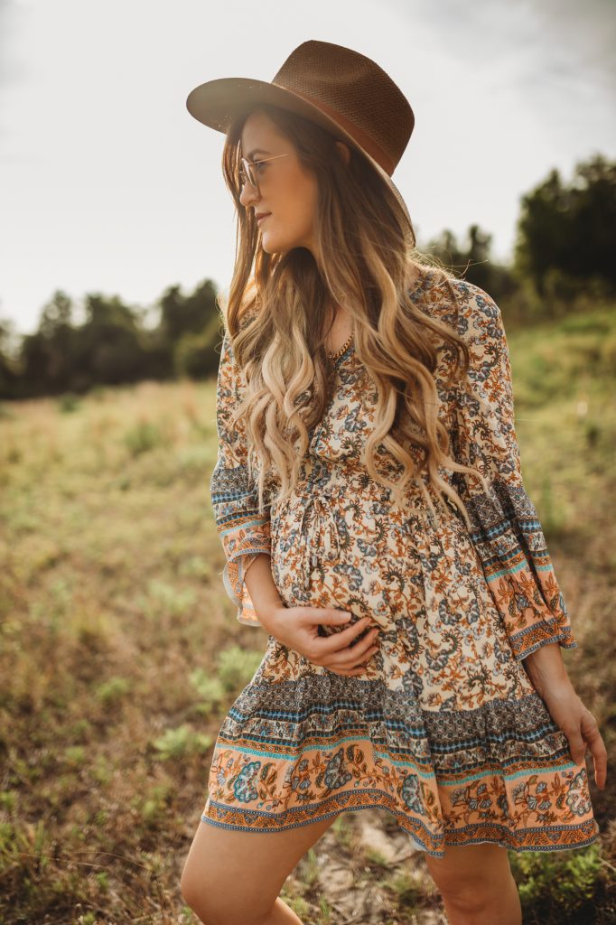Shannon Jenkins of Upbeat Soles styles a spring boho outfit with Chicwish floral dress, taupe booties, and Janessa Leone hat