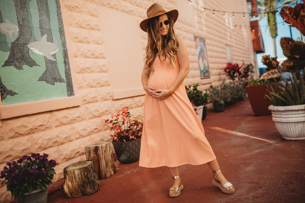 Shannon Jenkins of Upbeat Soles styles a summer H&M orange maxi dress with metallic sandals, and Janessa Leone hat