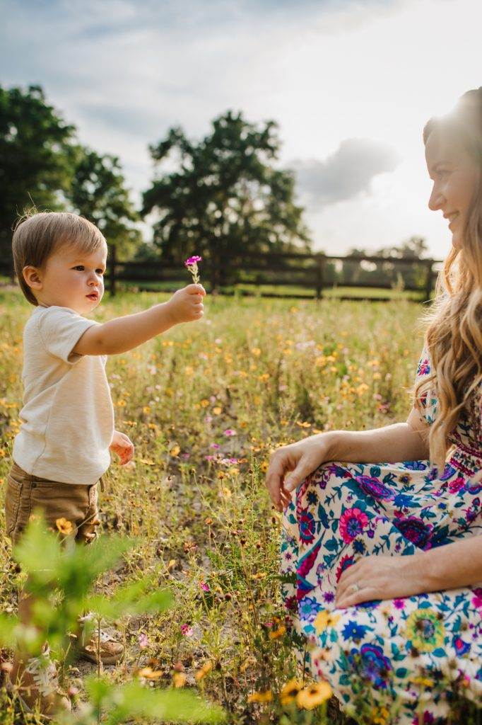 Shannon Jenkins of Upbeat Soles does a Mother's Day photoshoot with flower field pictures styled in a colorful floral maxi dress