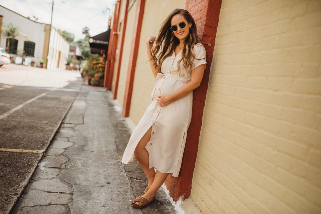 Shannon Jenkins of Upbeat Soles styles a classy maternity outfit with tie waist button up dress, brown slide sandals and layered necklaces