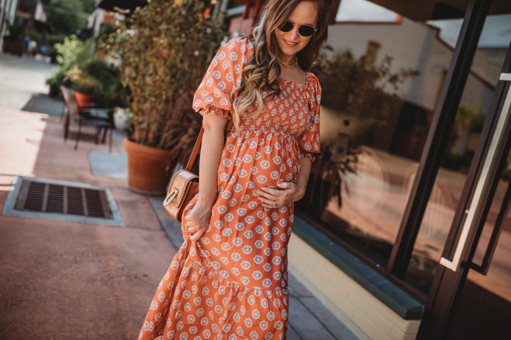 Shannon Jenkins of Upbeat Soles styles a summer maternity vacation outfit with Shein dress, gold espadrilles, and Ray Ban sunglasses