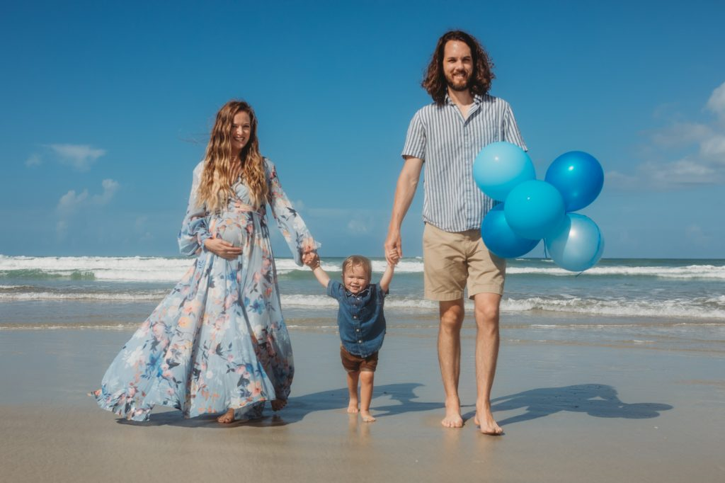 Shannon Jenkins of Upbeat Soles does a gender reveal photoshoot with balloons and Chicwish flowy dress and Electric Picks necklaces