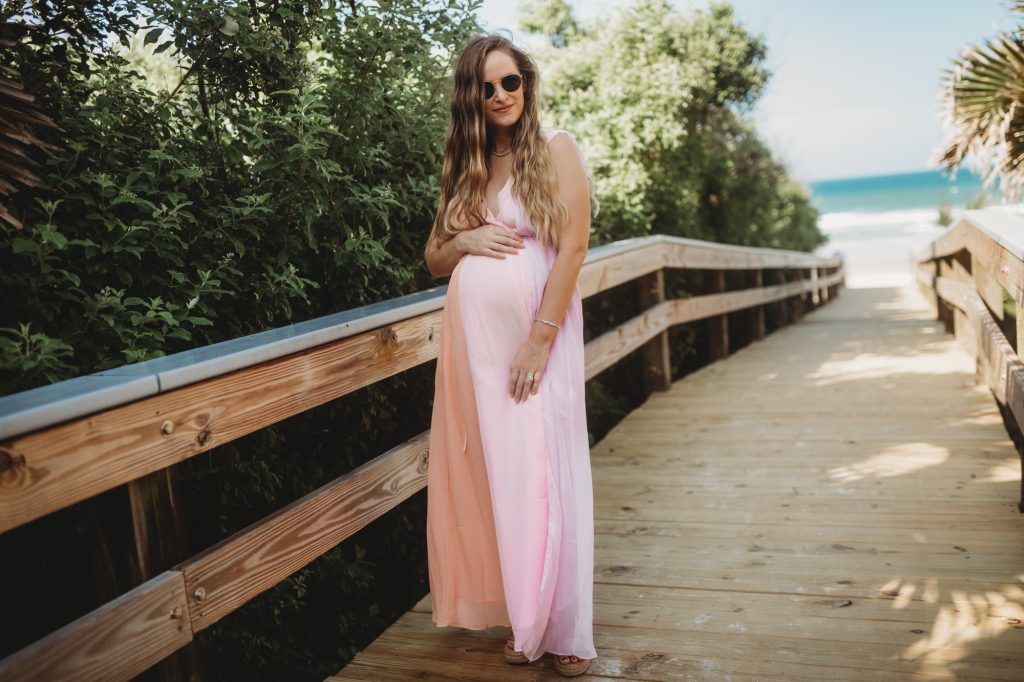 Shannon Jenkins of Upbeat Soles styles a summer maternity blush dress with low back, silver espadrilles and Ray Ban Icon sunglasses