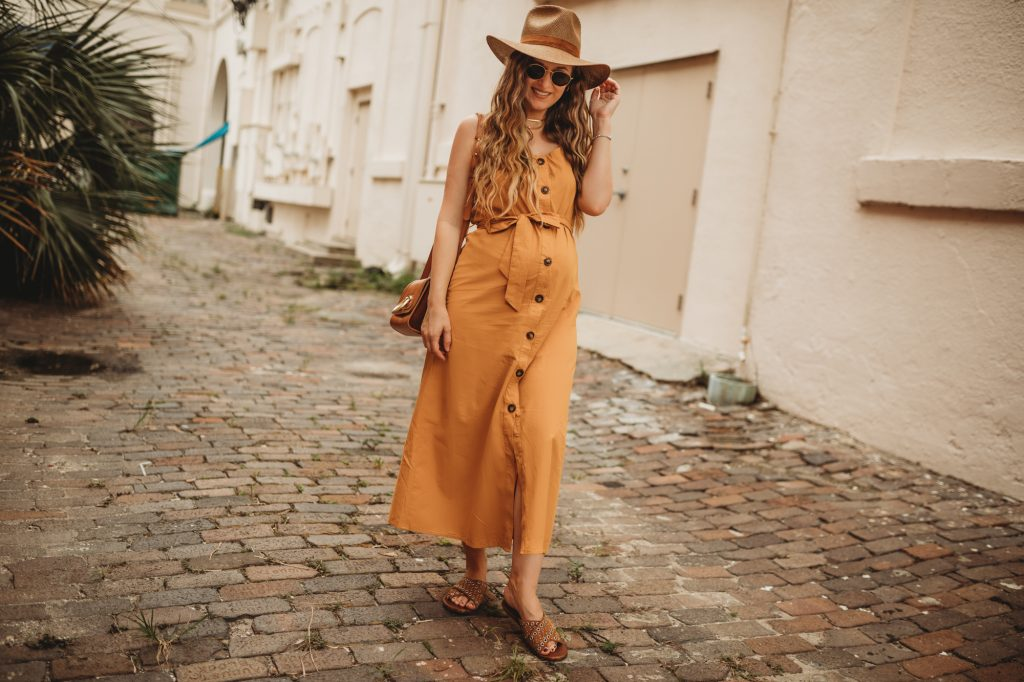 Shannon Jenkins of Upbeat Soles styles a casual maternity outfit with Shein button down dress, studded sandals, and Janessa Leone hat