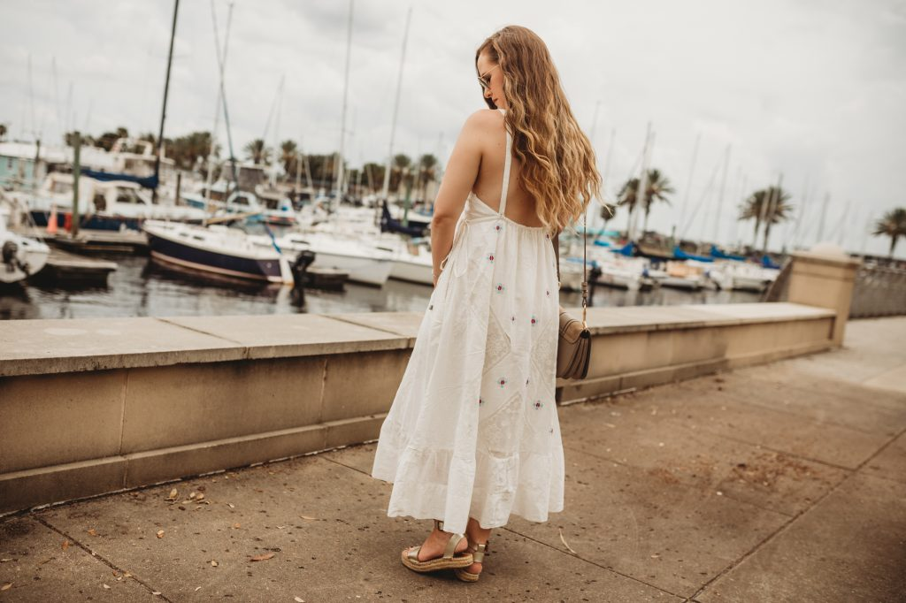 Shannon Jenkins of Upbeat Soles styles a summer maternity outfit with Free People embroidered dress, espadrille sandals, and Ray Bans