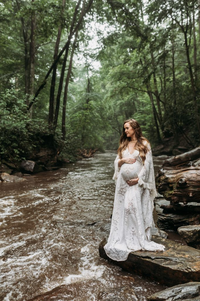Shannon Jenkins of Upbeat Soles posts her waterfall and forest maternity photography session wearing a Reclamation lace dress.